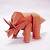 chalcopyrite: An origami model of a triceratops dinosaur made of brown paper, on a white field. (animals: triceratops)