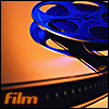 "jennifergearing: an old school film reel, film sweeping from the reel to the bottom left, which is captioned with ""film"" (media: film)"