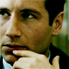 "lim: Mulder holding a finger to his mouth in a ""hmmmm"" type fashion (hm finger)"