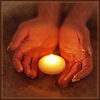 such_heights: a hand cupping a candle (stock: candle)