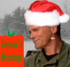 "thothmes: O'Neill with a Santa hat and ornament earring, Snowy background.  Present in foreground says ""Seasons Greetings. (Christmas Jack)"