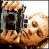 highlander_ii: Heath Ledger laying on his side holding an old camera like he's shooting a photo ([Heath L] photography)