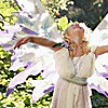 skygiants: a little girl spreads out arms and wings and beams up towards the sky (wings glee)