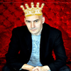 ktc: Grant Morrison, sitting on a red velvet throne, with a photoshopped crown on his head. (mcr - king grant)