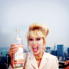 venusinthenight: a smiling patsy stone holding a bottle of vodka (abfab - happy patsy with booze!)