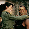 muccamukk: Vala hugging Teal'c, her legs wrapped around his waist. Both are smiling. (SG-1: Happy -hugs-)