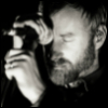quadruplify: Matt Berninger (lead singer of The National) with forehead on microphone, eyes closed ([Music] The National - microphone)