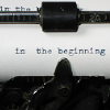 "manyworlds: Close-up of a sheet of paper in a typewriter, reading ""In the beginning"". ([writing] in the beginning)"