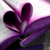 manyworlds: A book with pink-edged pages folded into a heart. ([reading] ♥)