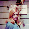 quiet_curiosity: blonde haired woman in front of a wall looking down (Forlon)