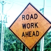 korone: a photo of a road work sign (*busy*)