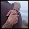wintercreek: Close-up of a woman's hands clasped behind a man's back during a hug. ([hands] hold on)
