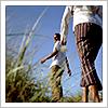 wintercreek: Two women walking on the beach through grass. ([misc] follow me out)