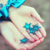 salted_caramel: Someone holds a handful of blue stars (Handfull of Stars)