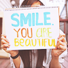 from: a sign that reads 'smile you are beautiful' (smile you are beautiful)