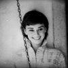 virginiahotchner: Audrey Hepburn smiling behind a chain, in black and white. (classy smiles, audrey hepburn, chain, black and white)