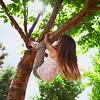 piwakawaka: (up a tree as a girl)