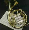 gramarye1971: a French horn resting on an open book of sheet music (French horn)