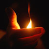 safekeeper: candleflame shielded by silhouetted hands. (warmth)