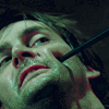 amor_remanet: David Tennant as Barty Crouch Jr., with a wand poking him in the cheek. (barty crouch jr. is a time lord.)
