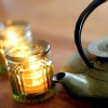 alwayswondered: A teapot with some lighted tea candles beside it. (Tea fixes everything.)