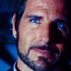 director_global: (blue-eyed intensity)