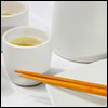 gramarye1971: white teacup of green tea with wooden chopsticks (Tea and Chopsticks)
