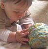 nightgigjo: A baby looking curiously at a ball of yarn. (ravelry, shmoog, knitting)