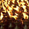 rising: a picture of many flames from tea-light height oil-candles (the cadre: candles)