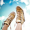 popetacular: a pair of chucks on feet, highlighted against the sky (stock ;; chucks)