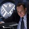 dizmo: A cap from a still from The Avengers movie featuring Agent Coulson with the SHIELD logo behind him. (mcu: agent coulson of shield)