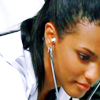 technocracygirl: Martha Jones in a lab coat, leaning over with a stethoscope (science)