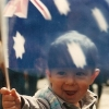 spacebutler: Me as a baby, holding the Australian flag. (Baby flag)
