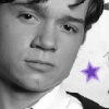 takhallus: Dan Byrd greyscale and purple star (mylar cartoon)