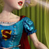 odditycollector: Crop of soft coloured Supergirl in a vintage style dress. Her symbol and lower face are visible. (Supergirl)