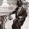 eccentric_hat: A man in a top hat and suit petting a tiger. (tiger)