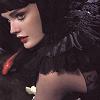 mochi: A woman in dark clothing (dramatic)