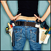 sofiaviolet: rear view of a woman wearing a heavily burdened tool belt (handy)