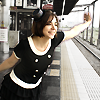mochi: myself, dressed up fancy and being silly/cute at a train station (flying, fun)