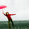 elizabeth: figure with a red umbrella dancing (dancing in the street)