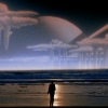 wallwalker: A man standing on the edge of a beach and looking up at a massive ringed planet and distant odd clouds (personal apocalypse)