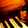 cleo: Piano keys with a glass of whiskey sitting on them...reminds me of the short story Sonny's Blues (Stock: Sonny's Blues)