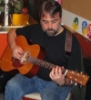 uwf: Me playing a show at 10th Avenue Burrito at the end of 2011. The beard, sadly, is gone for now. (uwf guitar picture)