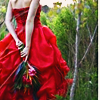 cleo: (Stock: Red dress and flowers surprise)