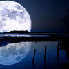 musyc: A full moon half over the horizon, reflected in water (Stock: Full moon in blue)