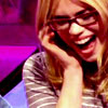 kiki_eng: actress, Billie Piper, wearing red glasses and laughing with her face scrunched up (Billie Piper is happy laughing joyful)