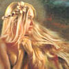 amulet: a woman with long blonde hair and flowers in her hair (windblown)
