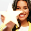 berrystar: Rachel Berry smiling and holding up a large gold star. (star of the show)
