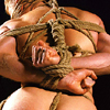ysobel: The back of a naked man in rope bondage, wrists tied together and fists clenched (kink)