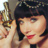 st_aurafina: close in crop of Phryne Fisher, 1920's lady detective, with a gold snub nose revolver (Miss Fisher: Phryne)